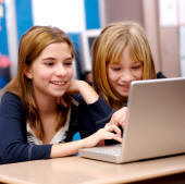 young girls safely enjoying internet experience